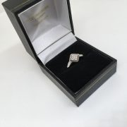 Preowned 9 carat white gold diamond cluster ring