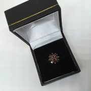 Preowned 9 carat yellow gold garnet ring