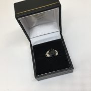 Preowned 18 carat white gold garnet and diamond ring