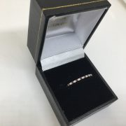 Preowned 9 carat yellow gold garnet and diamond ring