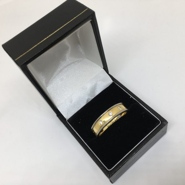18 carat 2 colour gold 6mm band with diamonds