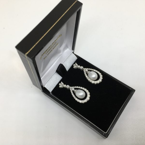 18 carat white gold pearl and diamond drop earrings