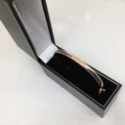 9 carat rose gold hinged bangle