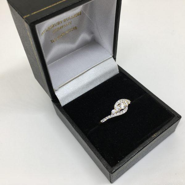 18 carat yellow gold diamond crossover ring