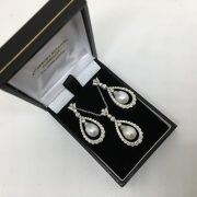 Preowned 18 carat white gold pearl and diamond earring and pendant set