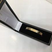 9 carat yellow gold screw on baby bangle