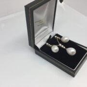 18 carat yellow gold pearl and diamond earring and pendant set