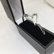 Preowned 18 carat white gold diamond heart bangle