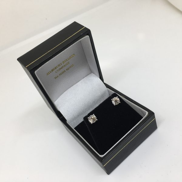 9 carat white gold single stone diamond stud earrings