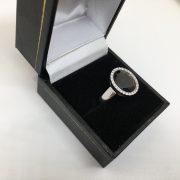 9 carat white gold garnet and diamond ring