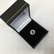 Preowned 18 carat yellow gold ruby and diamond cluster ring
