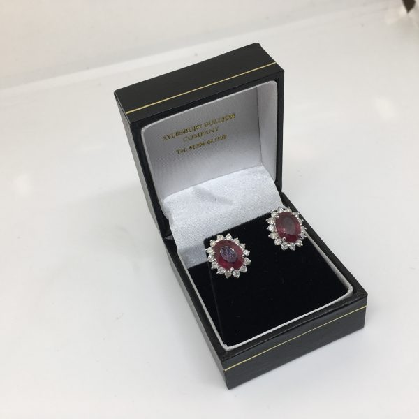 Preowned 14 carat ruby and diamond cluster earrings