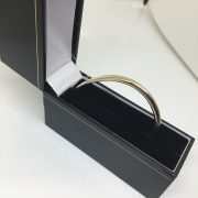 Preowned 9 carat yellow gold torque bangle with ID plate