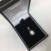 Preowned 9 carat yellow gold sapphire and opal pendant