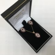 Preowned 9 carat yellow gold ruby and diamond pendant, chain and earring set