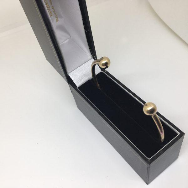 Preowned 9 carat yellow gold torque bangle