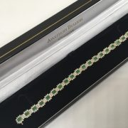 Preowned 9 carat 2 colour emerald and diamond bracelet