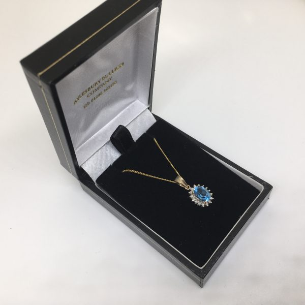 9 carat yellow gold blue topaz and diamond pendant and chain