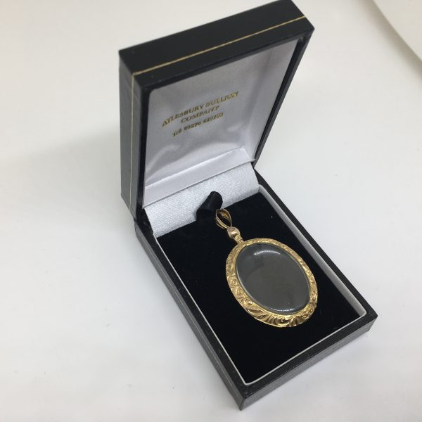Preowned 9 carat yellow gold open faced engraved locket
