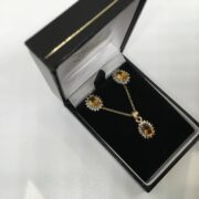 9 carat yellow gold citrine and diamond pendant, chain and earring set
