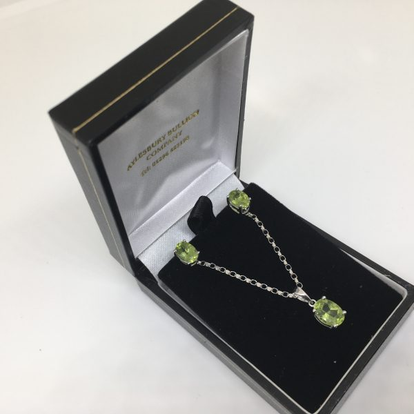 9 carat white gold peridot pendant, chain and earring set