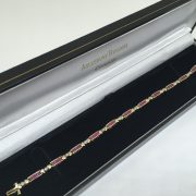 Preowned 9 carat yellow gold ruby and diamond bracelet