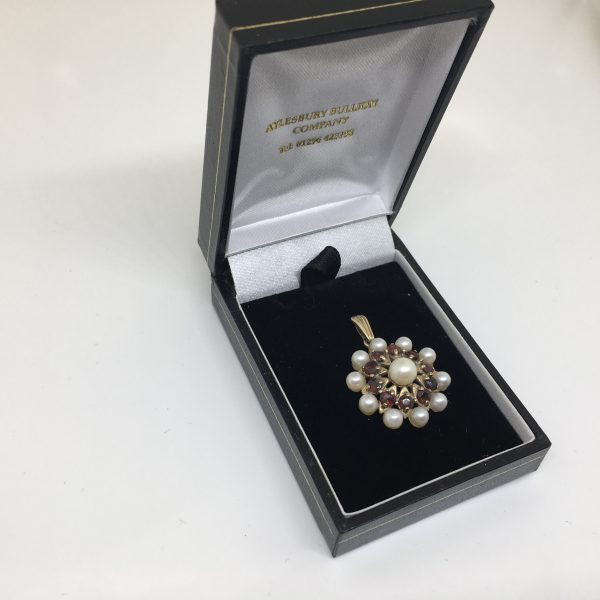 Preowned 9 carat yellow gold garnet and pearl pendant