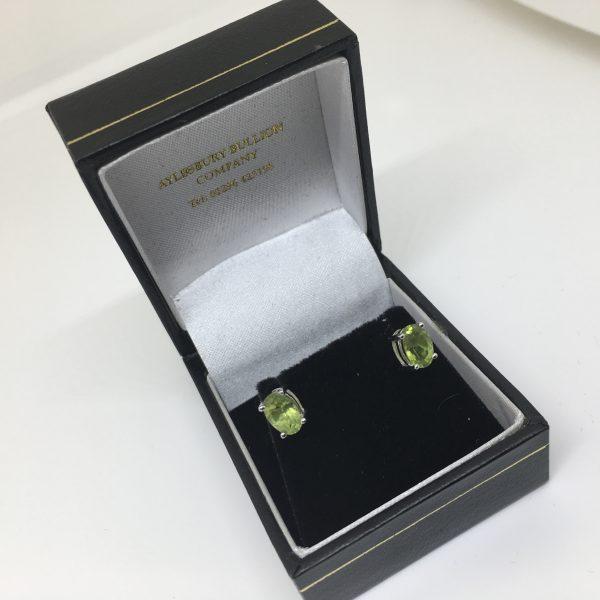 9 carat white gold peridot stud earrings