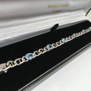 Preowned 9 carat white gold blue topaz bracelet