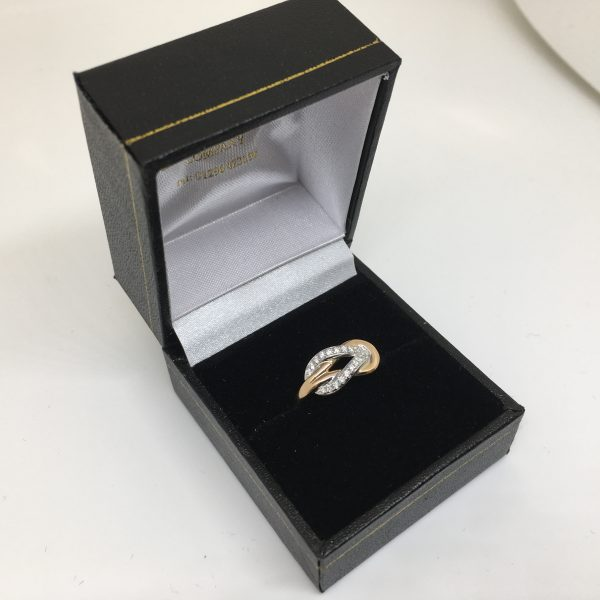 18 carat rose gold diamond knot ring
