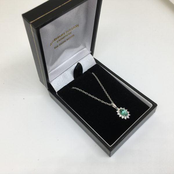 9 carat white gold emerald and diamond pendant and chain