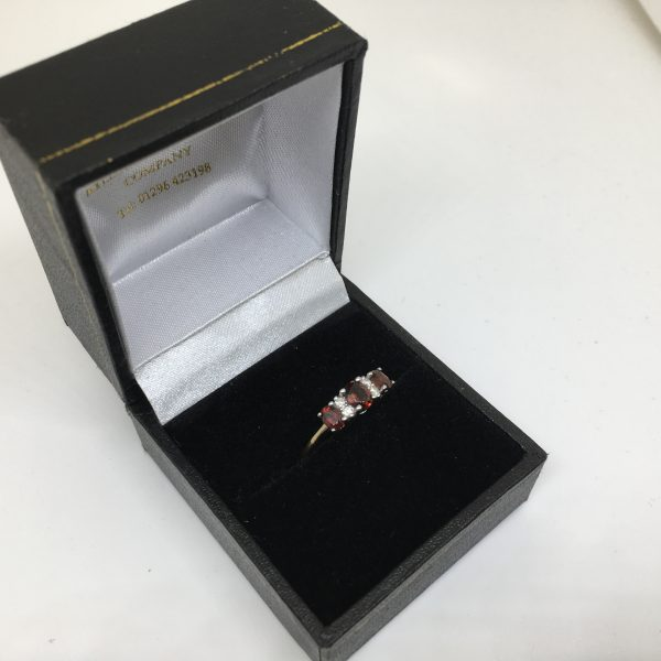 9 carat yellow gold garnet and diamond ring