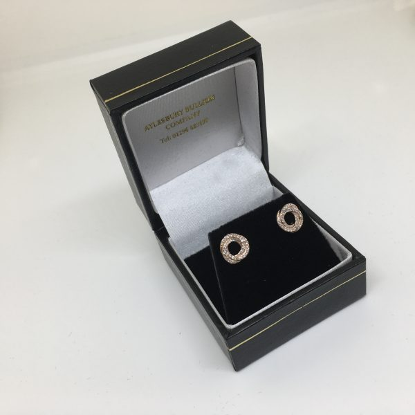 9 carat rose gold diamond twist earrings