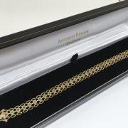 Preowned 9 carat yellow gold emerald bracelet