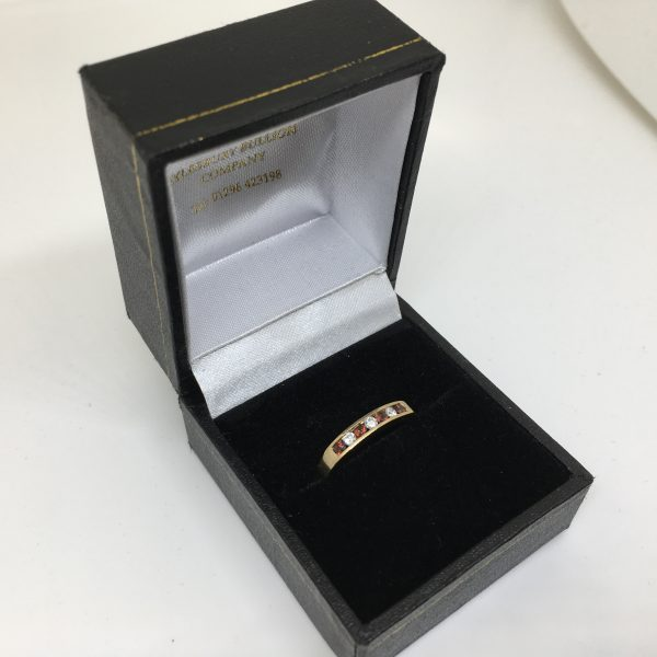9 carat yellow gold garnet and diamond ring