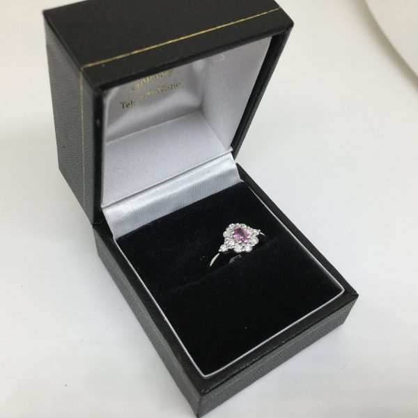 18 carat white gold pink sapphire and diamond cluster ring