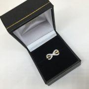 18 carat yellow gold diamond infinity ring