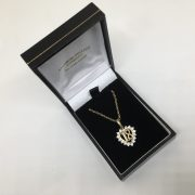 9 carat yellow gold CZ 18 pendant and chain
