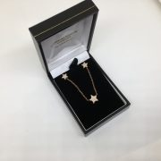 9 carat rose gold diamond star pendant, chain and earring set