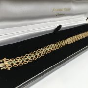 Preowned 9 carat yellow gold emerald bracelet