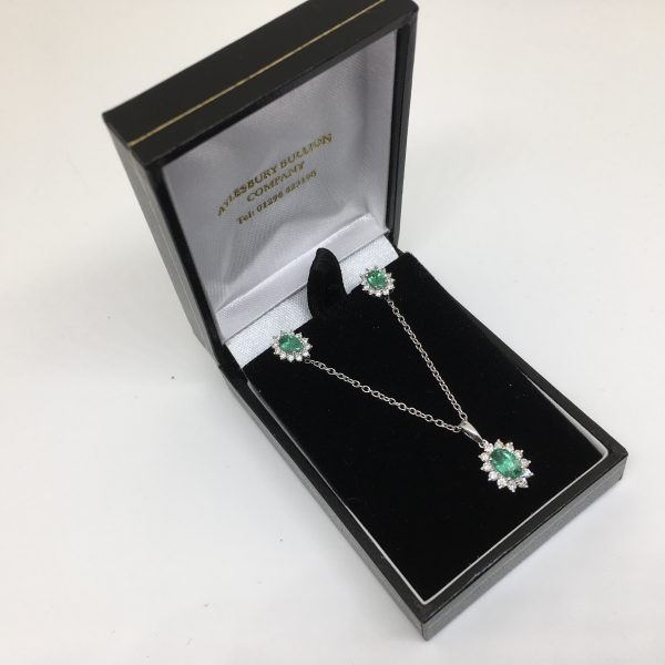 9 carat white gold emerald and diamond pendant, chain and earring set
