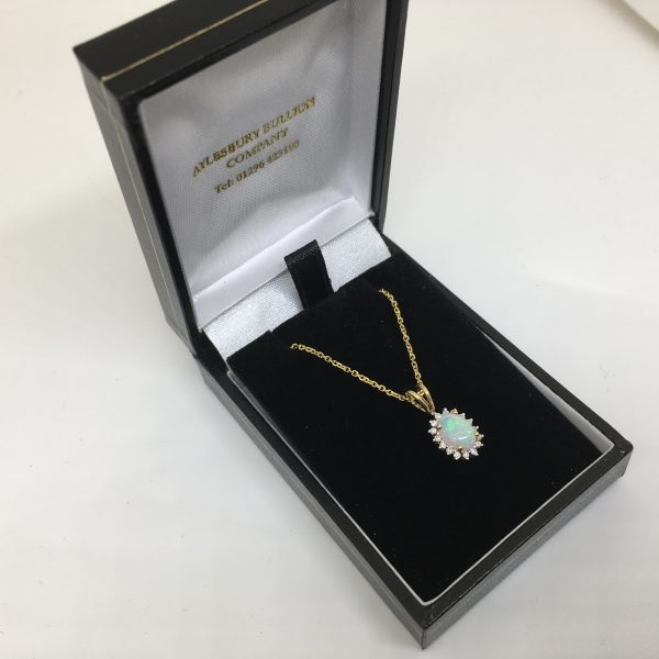 18 carat yellow gold opal and diamond pendant and chain