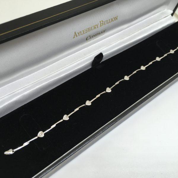 Preowned 9 carat white gold diamond heart bracelet