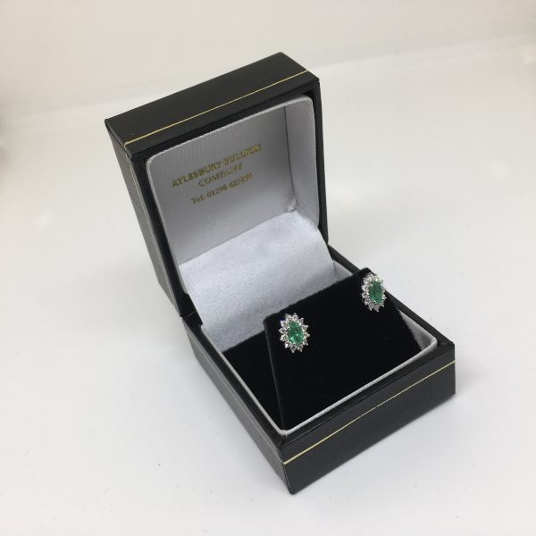 9 carat white gold emerald and diamond earrings