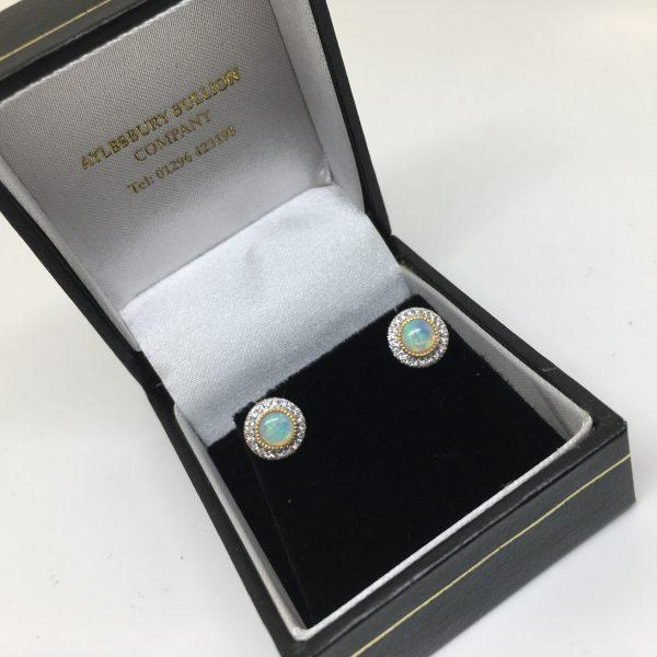 18 carat yellow gold opal and diamond stud earrings