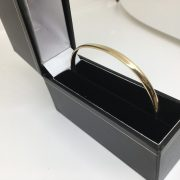 9 carat yellow gold solid oval bangle