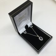 9 carat white gold sapphire and diamond pendant, chain and earring set