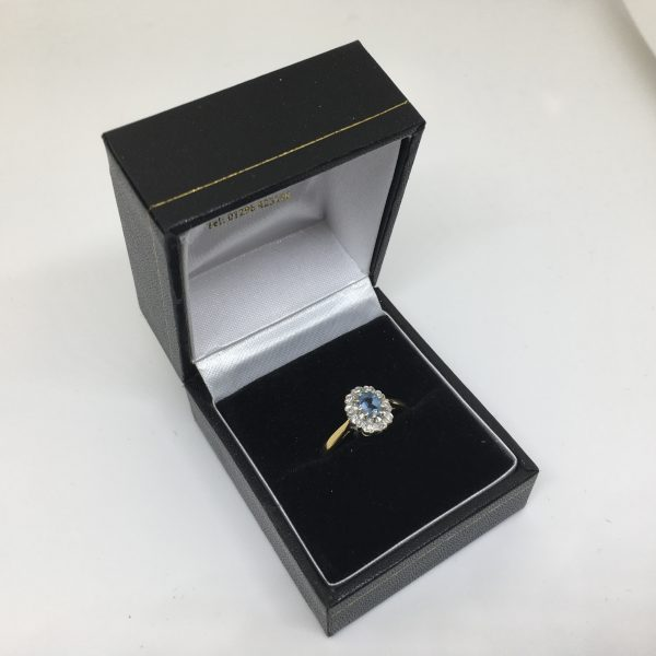 Preowned 18 carat yellow gold aqua marine and diamond ring