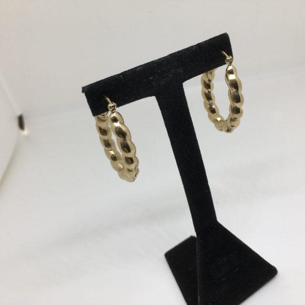 9 carat yellow gold oval hoop earring