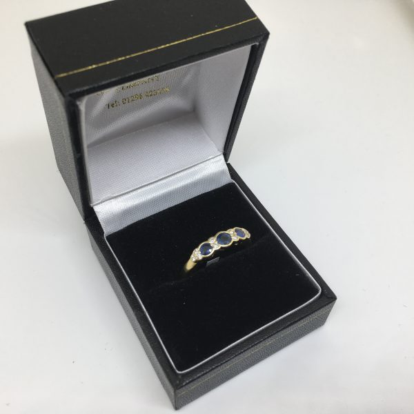 Preowned 18 carat yellow gold sapphire and diamond ring